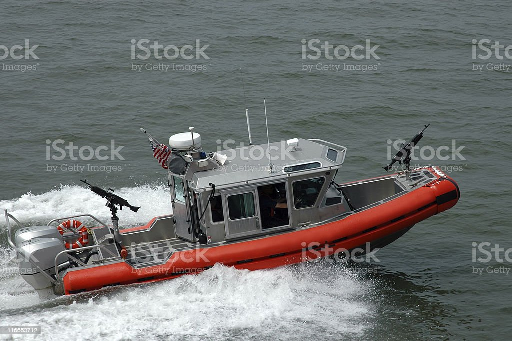 Boat with guns from the US Coast Guard stock photo