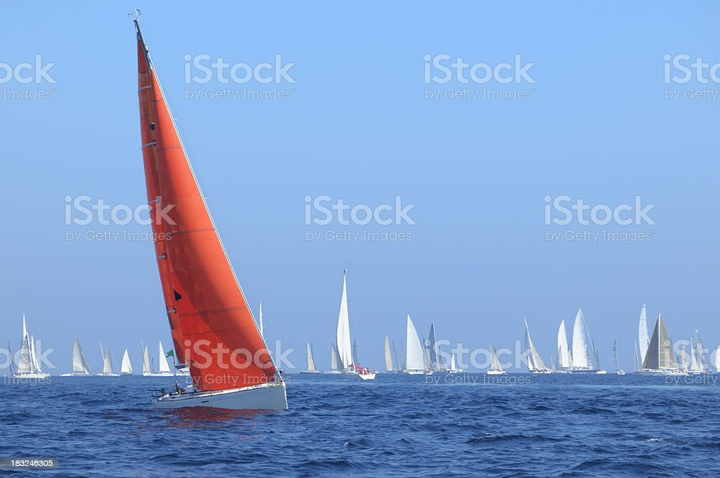 Boat with red sail stock photo