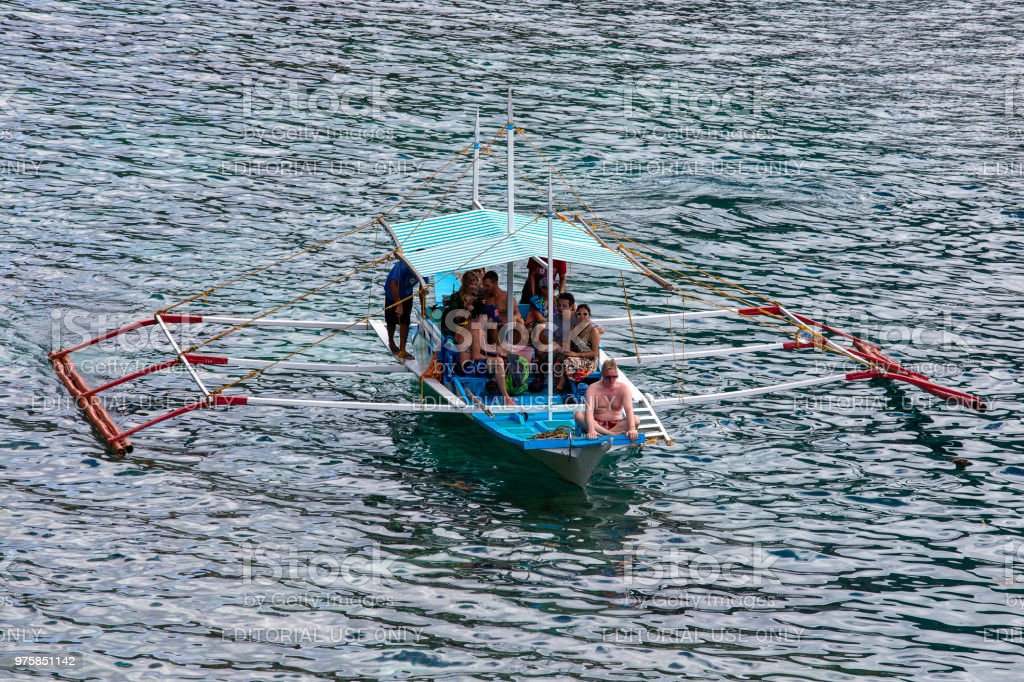 EL NIDO, PHILIPPINES - Boat with tourists on sea water to travel between the islands stock photo