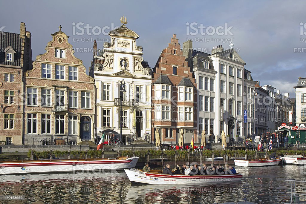 Boat with tourists on the Leye river, Ghent, Belgium. stock photo