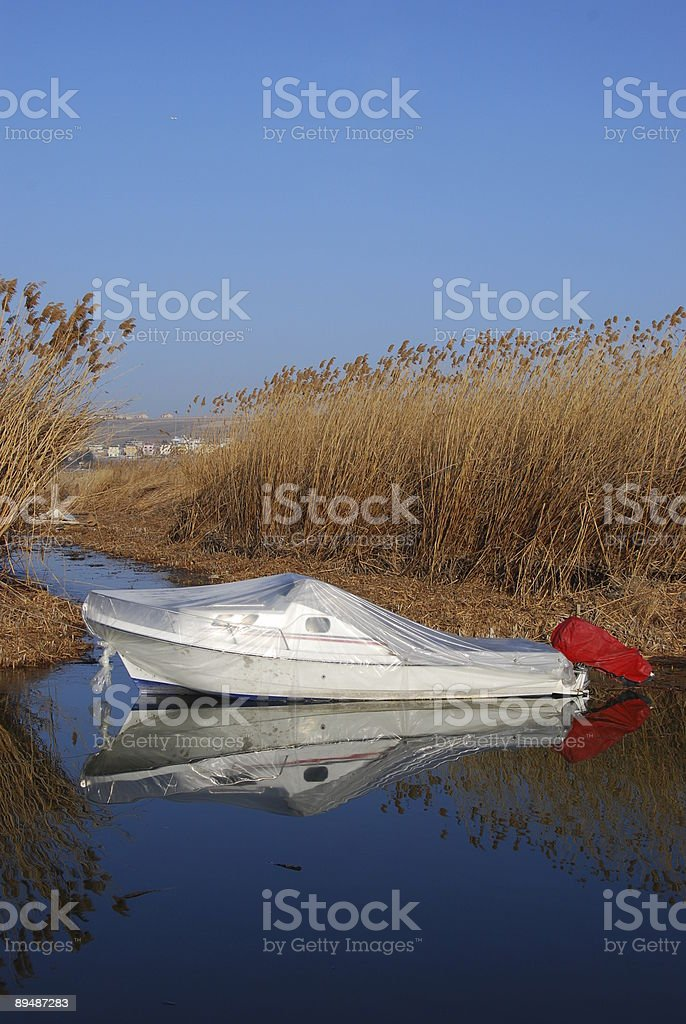 Boat wrapped for winter stock photo