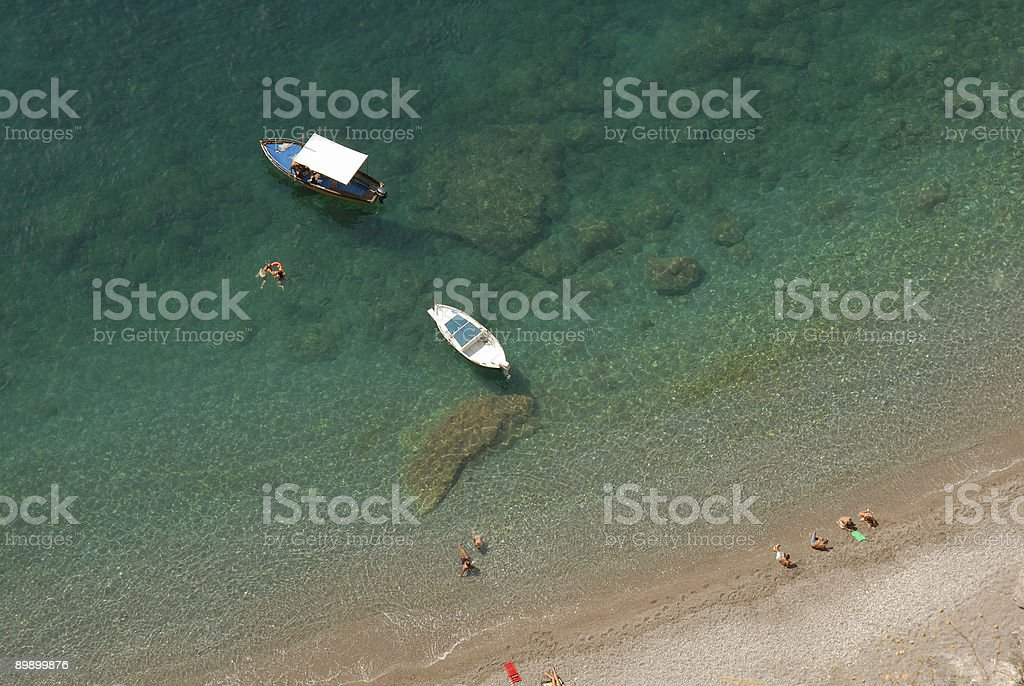 Boaters relaxing on the beach, Amalfi coast, Italy royalty-free stock photo