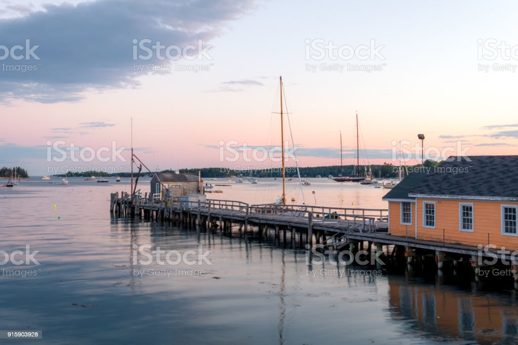 Boathouse and dock in the calm and beautiful Boothbay Harbor at dusk stock photo