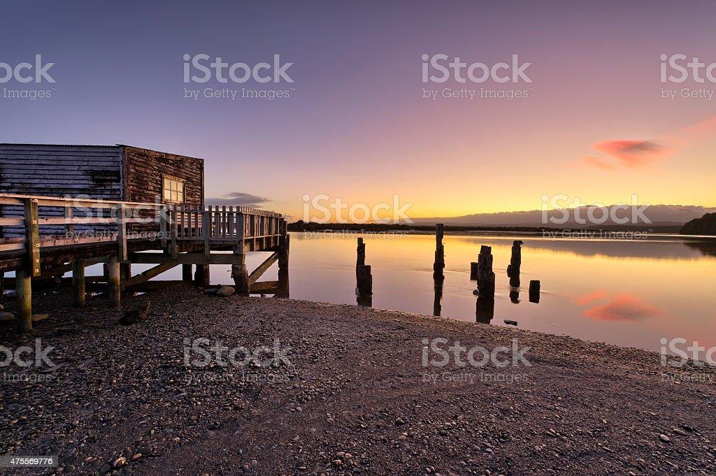 Boathouse on the shores of Okarito Lake stock photo