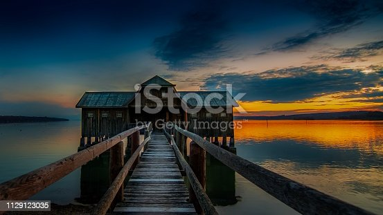 Ammersee wooden boathouse with long pier