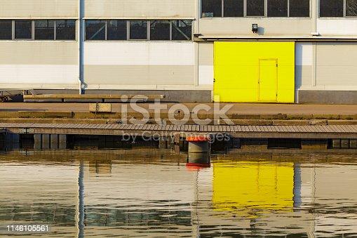 Hangar with yellow sliding door at marina