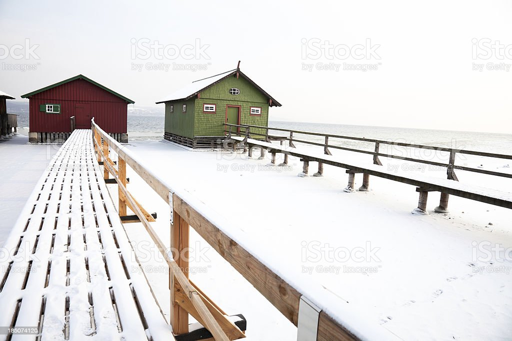 Boathouses in winter stock photo