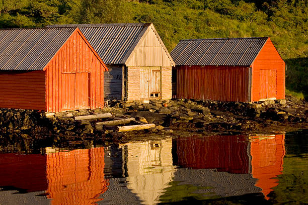 Boathouses with reflection, Bergen area, Norway. stock photo
