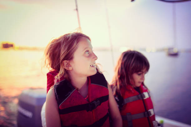 Boating at dusk stock photo