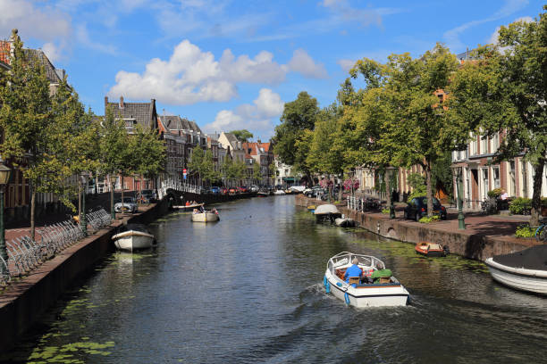 Boating in a canal in Leiden, Holland stock photo