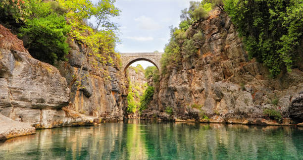 Boating in the Bridge Canyon of Manavgat River in Antalya, Turkey stock photo