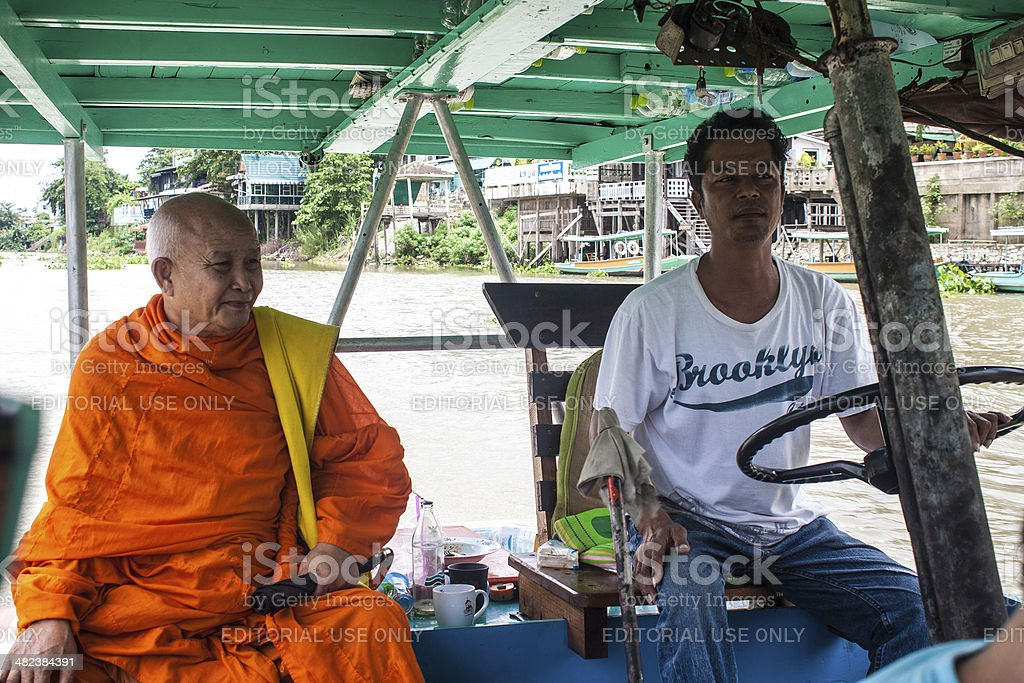 Boatman and monk on a ferry royalty-free stock photo
