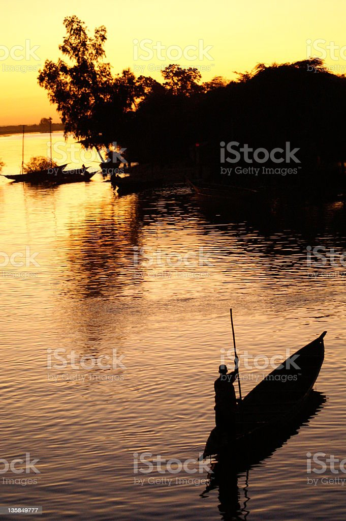 Boatman on river Niger in Mali royalty-free stock photo