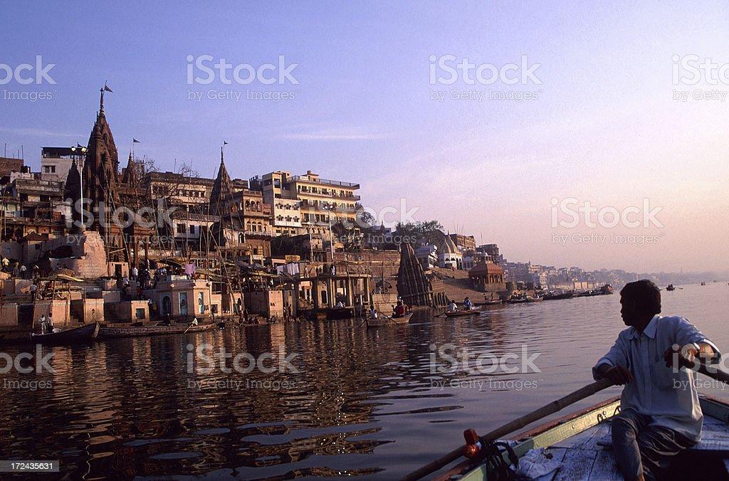 Boatman on the Ganges River at Dawn. Varanasi, India royalty-free stock photo
