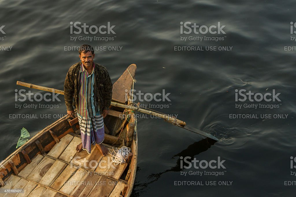 Boatman waiting for a client royalty-free stock photo
