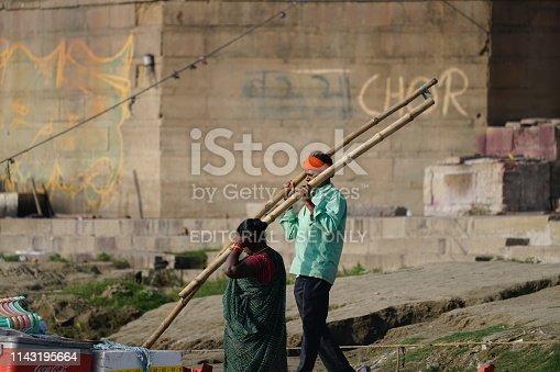 Varanasi, Uttar Pradesh, India - 24 March 2019: Boatman work at river Ganga