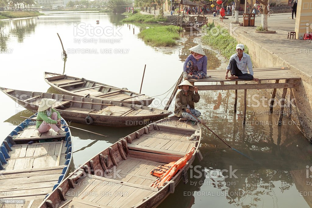 Boatmen are waiting for tourists, Hoi An, Vietnam royalty-free stock photo
