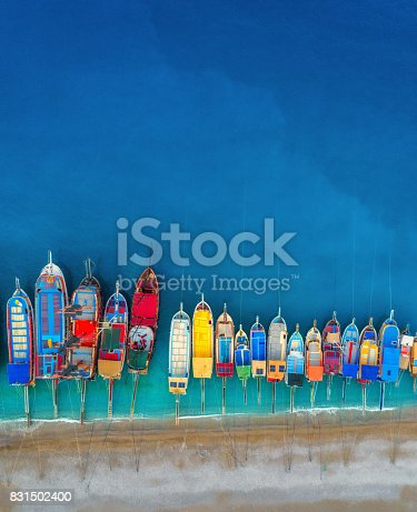 Boats. Aerial view of colorful boats in mediterranean sea in Oludeniz, Turkey. Beautiful summer seascape with ships, clear azure water and sandy beach in sunny day.Top view of yachts from flying drone