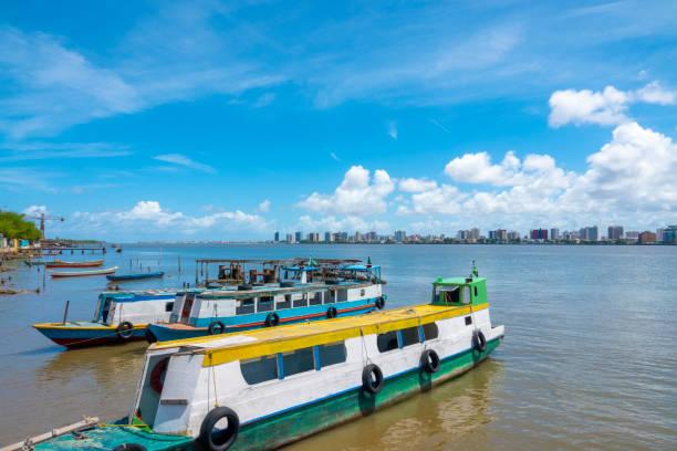 Boats anchored in Barra dos Coqueiros stock photo