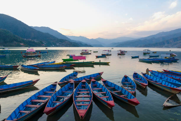 Boats and Fewa Lake stock photo