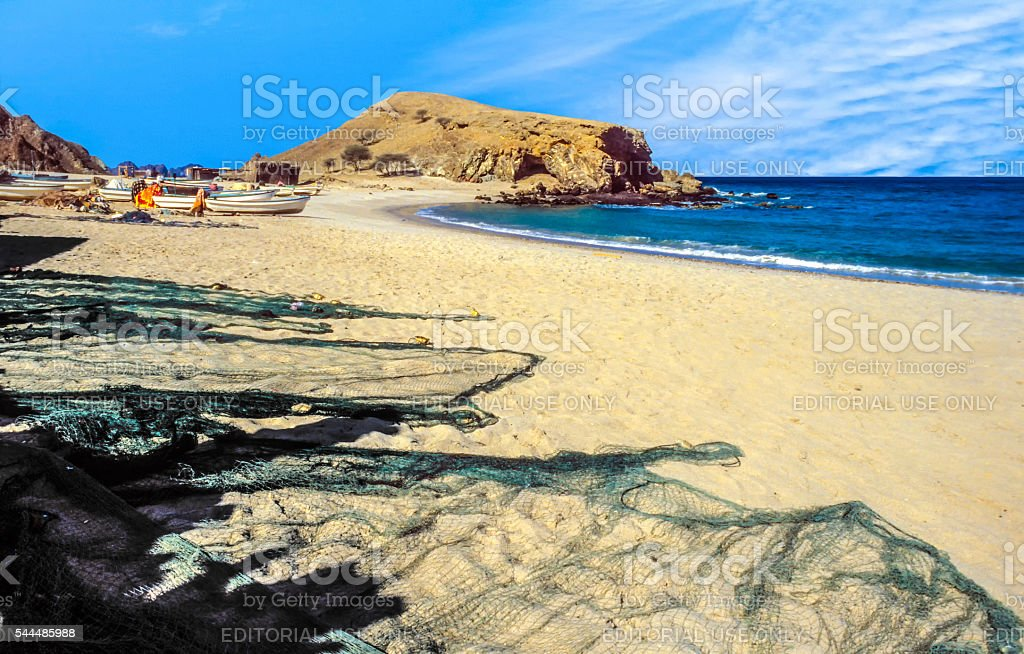 boats and fishermens net at the beach of Quantab stock photo