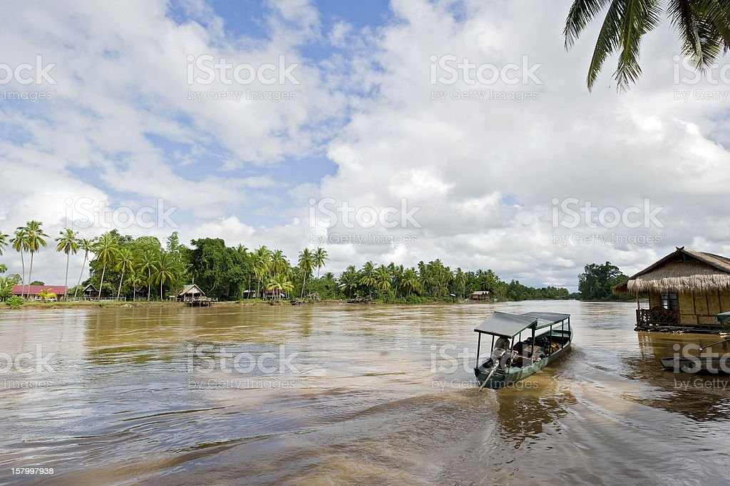 Boats and floating house at Mekong River, Cambodia stock photo