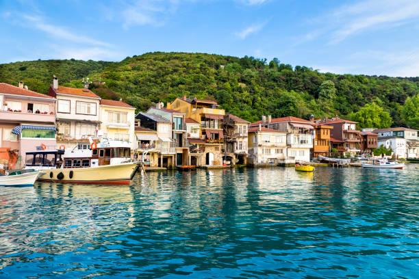 Boats and houses at Anadolu Kavagi village seaside stock photo