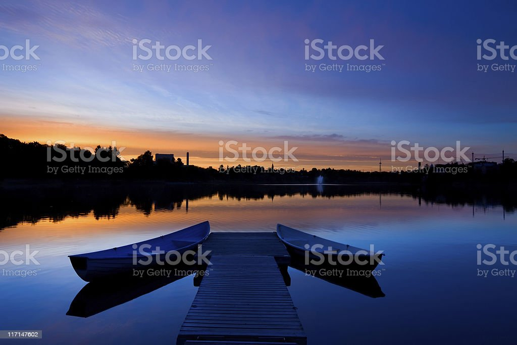 Boats and Jetty at Sunset in Helsinki Finland Downtown Park stock photo