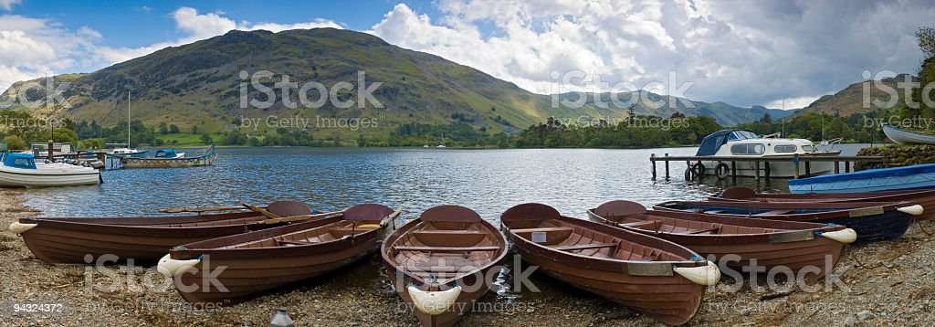 Boats and jettys on lake shore stock photo