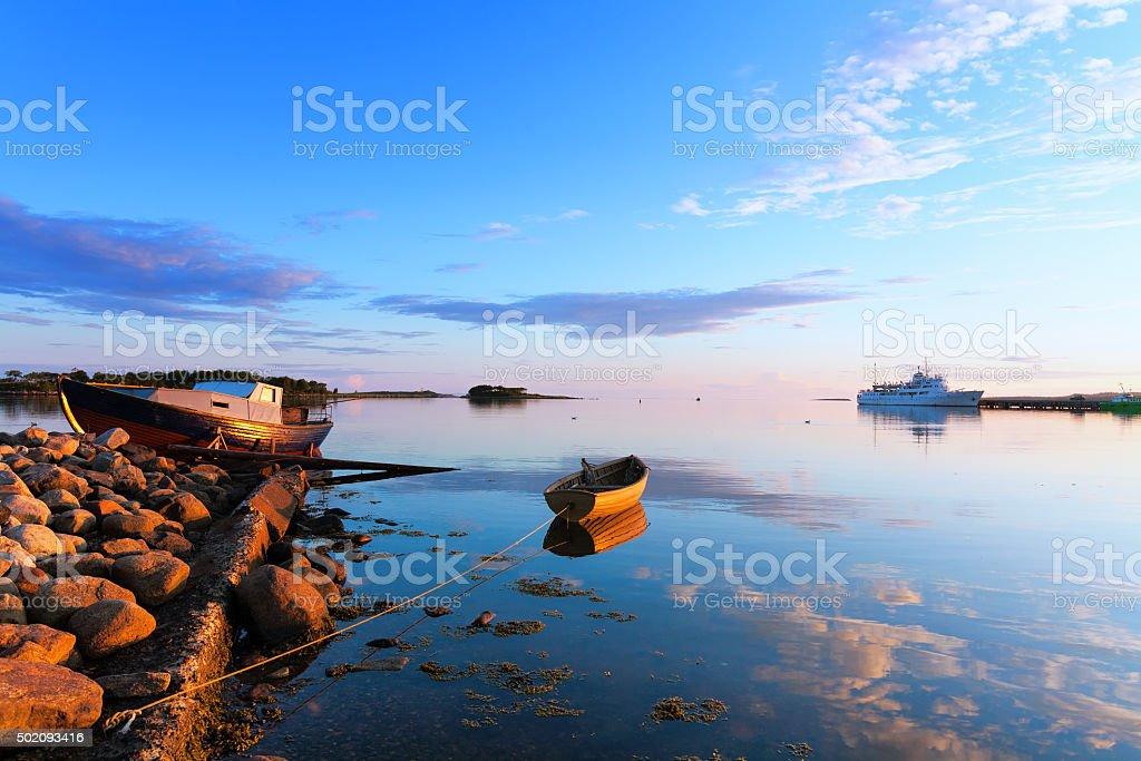 Boats and passenger ship of coast of Big Solovetsky Island. stock photo