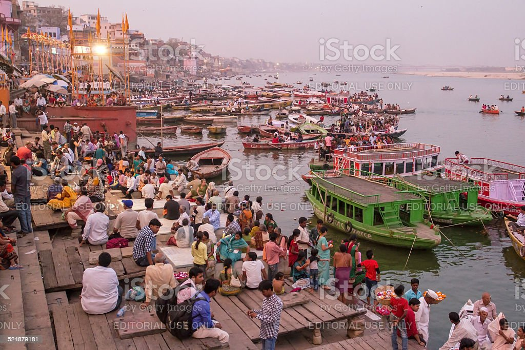 Boats and people on the ghats in Varanasi stock photo