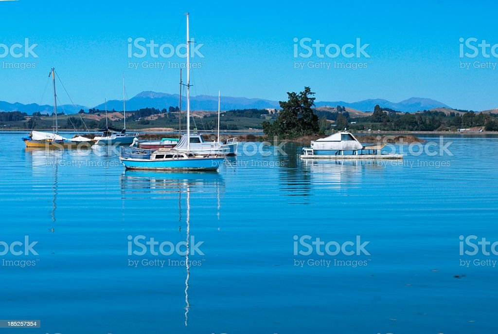 Boats and Reflections at High Tide stock photo