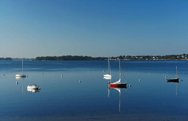 bateaux et réflexions dans le golfe du Morbihan - Photo