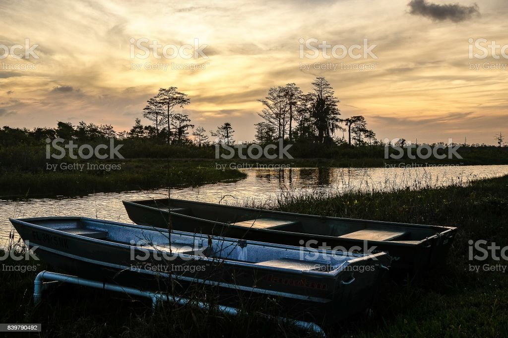 boats and Sunset in the Swamp stock photo