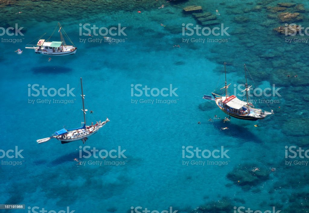 Boats And Swimmers seem to be flying stock photo