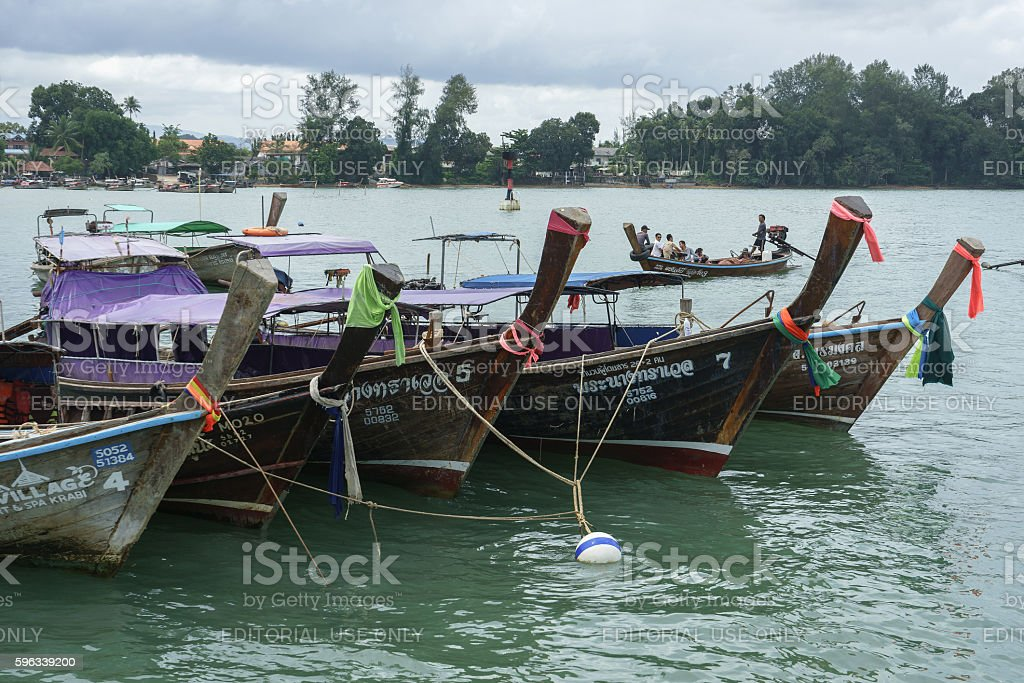 Boats and tourists at Ao Nammao pier in Krabi, Thailand royalty-free stock photo
