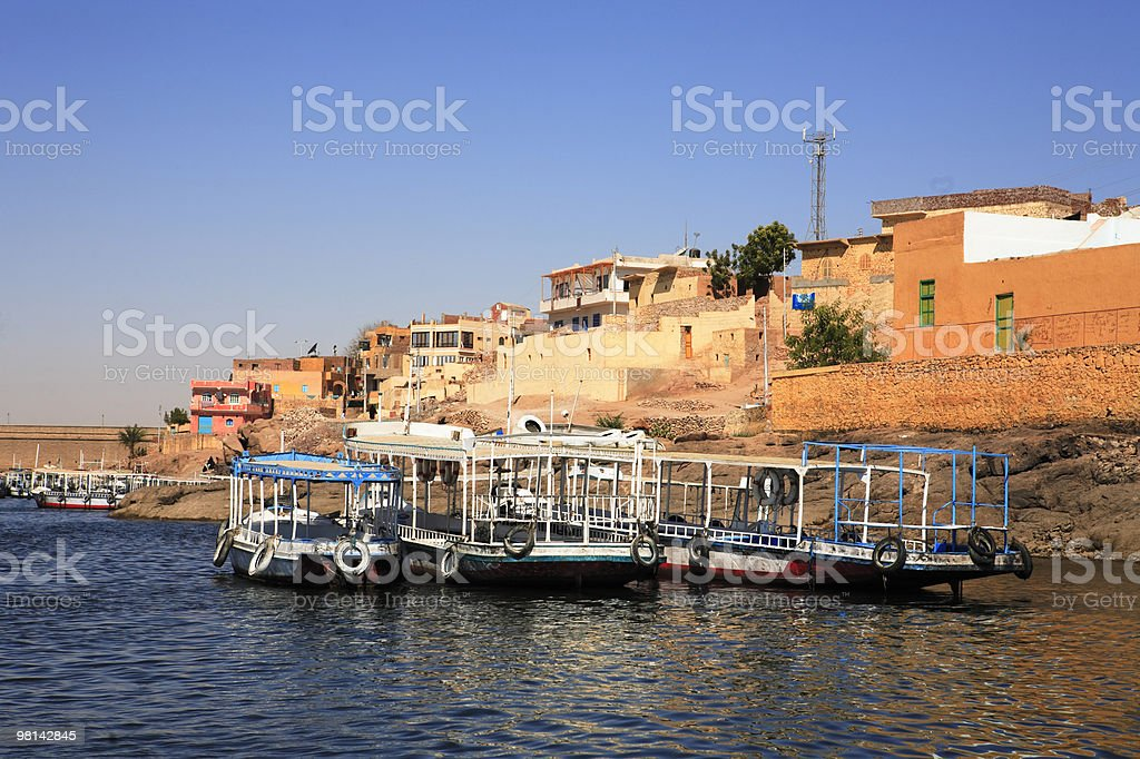 boats and village  nasser lake in aswan egypt royalty-free stock photo