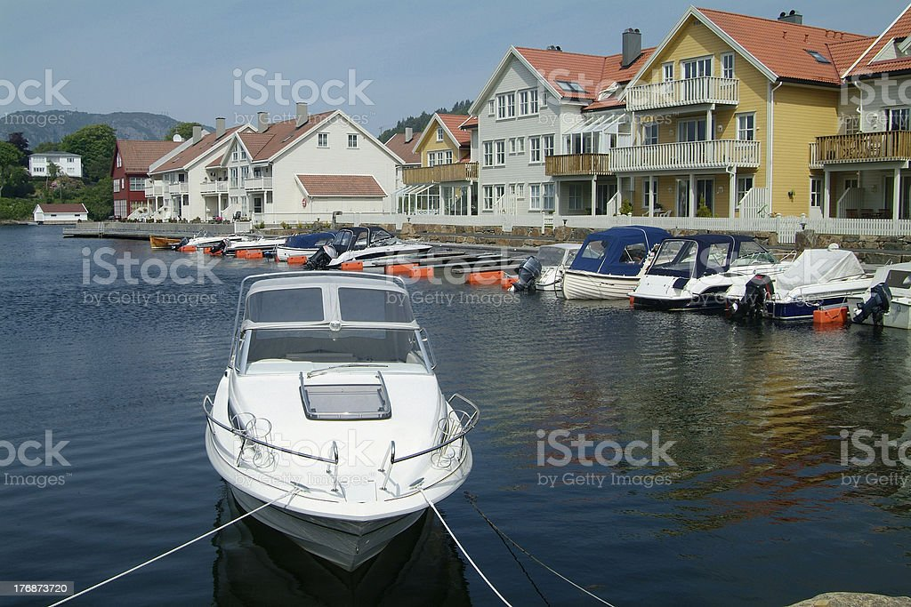 Boats and water-front houses stock photo