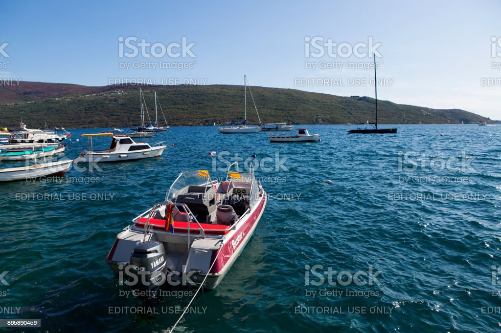 boats and yachts docked at the pier in the Bay of Montenegro stock photo