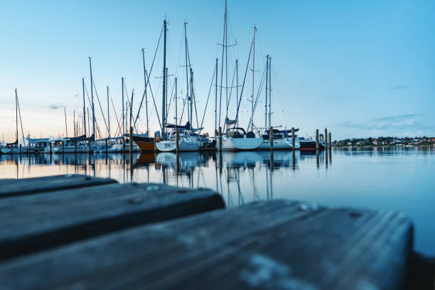 Boats and yachts in a bay of Roskilde in Denmark. stock photo
