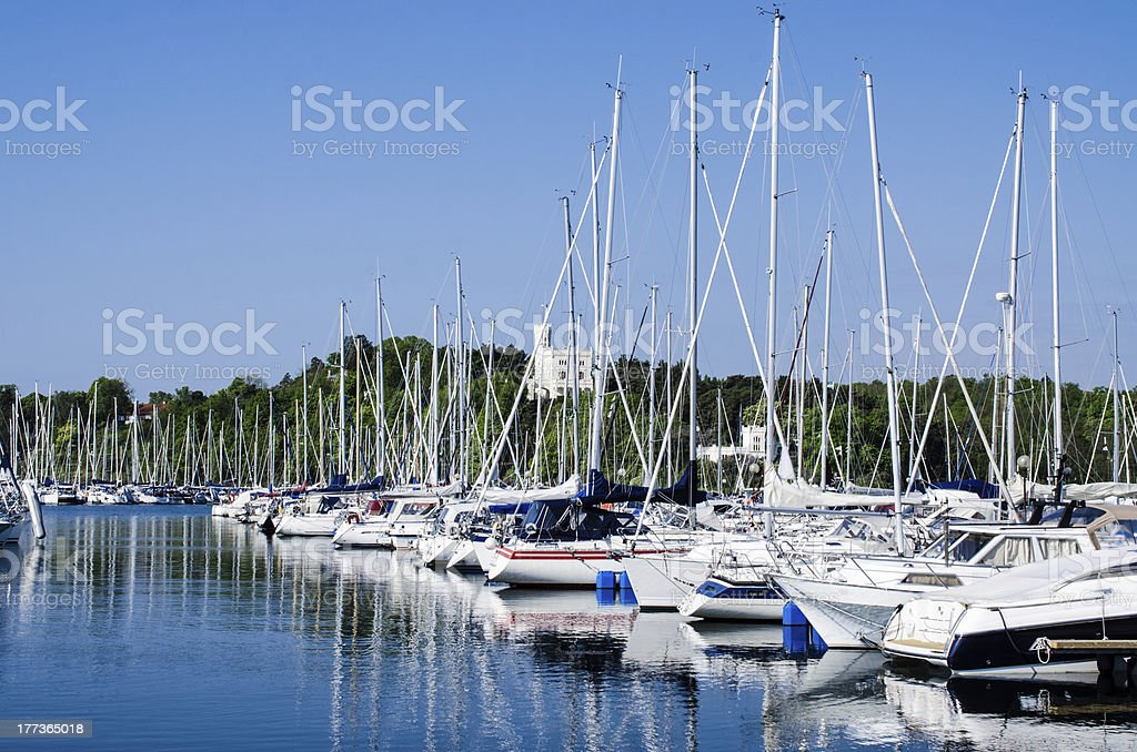 Boats  and yachts in the harbor royalty-free stock photo