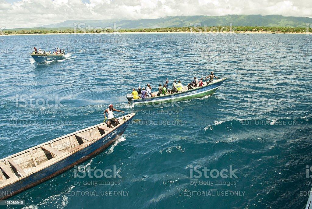Boats are bringing passengers to MV Liemba vessel, Lake Tanganyika stock photo