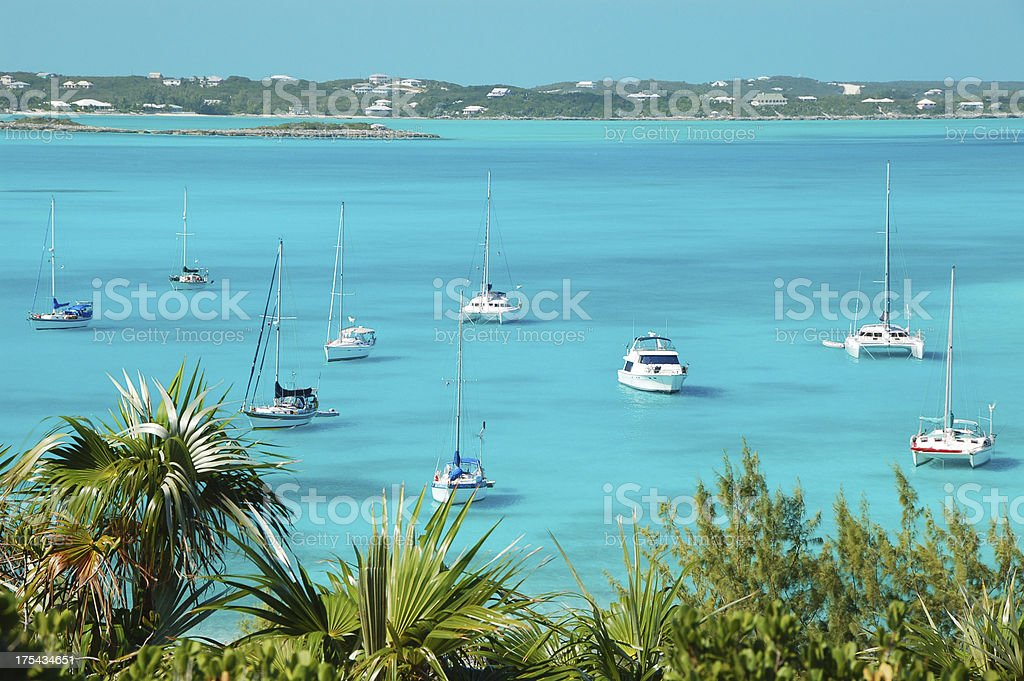 Boats at anchor, Stocking Island, Bahamas stock photo
