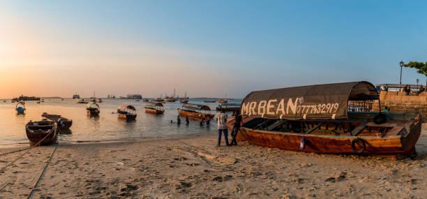 Boats at beach in Zanzibar on Indian Ocean stock photo