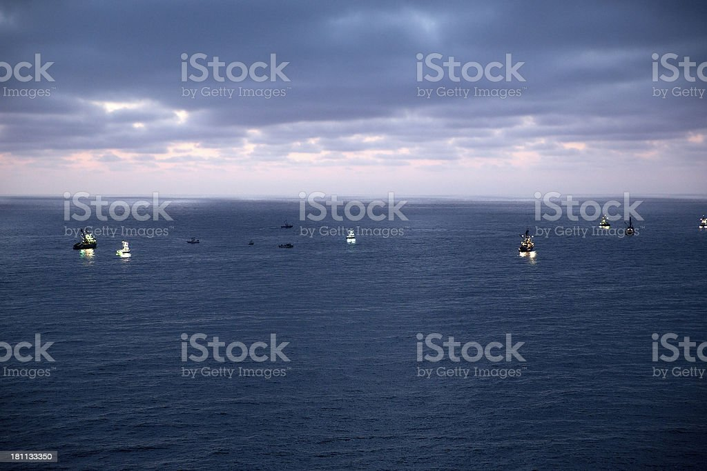 Boats at Dusk on the Pacific Ocean stock photo