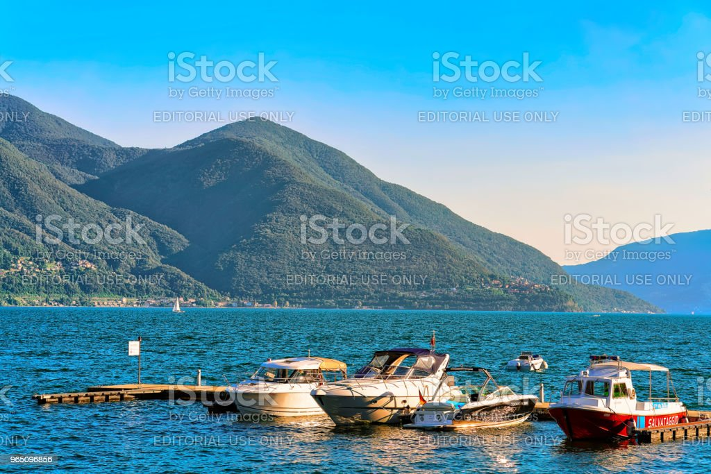 Boats at embankment in Ascona resort in Ticino Switzerland CH royalty-free stock photo