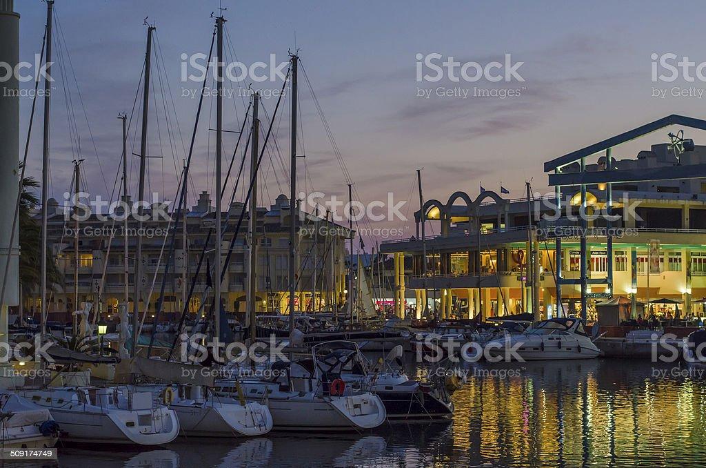 Boats at harbor in Puerto Marina at night stock photo