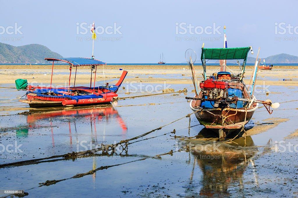 Boats at low tide, Rawai beach, Phuket, Thailand stock photo