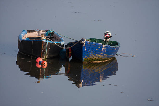 Boats at low tide, River Suir, Waterford, Ireland stock photo