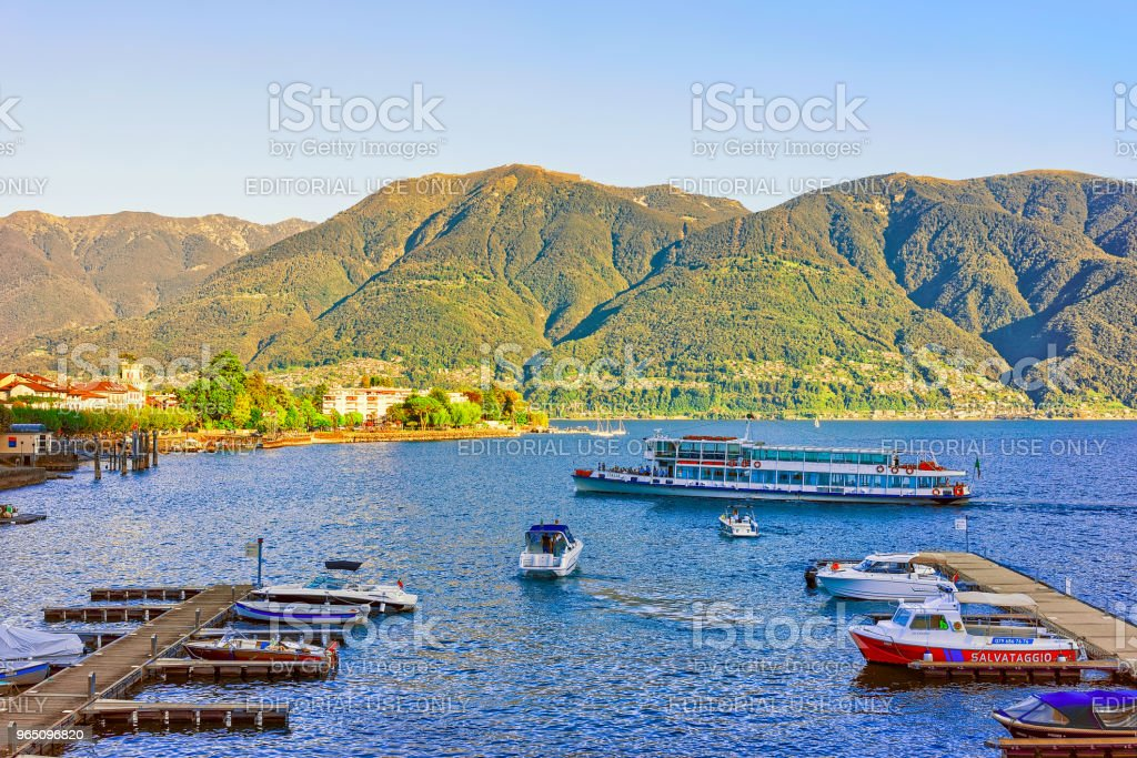 Boats at pier in Ascona in Ticino in Switzerland CH royalty-free stock photo